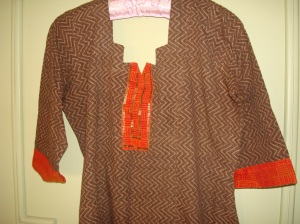 orange sequin yoke on brown