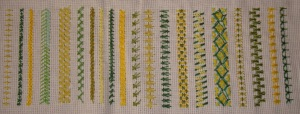 31.79.26.chained cross stitch sampler2