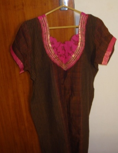 pink yoke on brown tunic