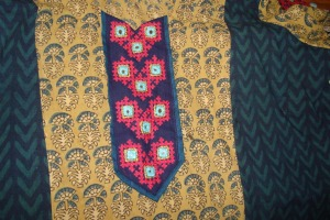 kutchwork on olive green and indigo tunic-yoke