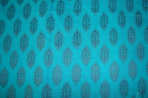 mirrors stones on black/blue tunic-sleeve fabric
