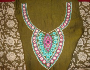 mirrorwork on green tunic-yoke
