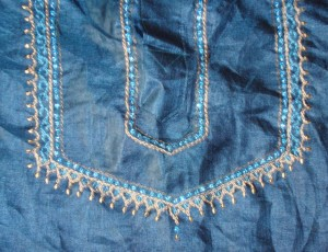 emb on blue kurtha- detail