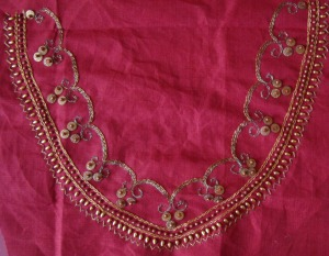 gold beads on maroon neck design