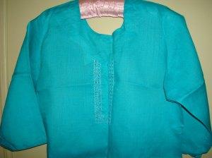 mirror on blue linen tunic