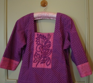 violet beads on pink yoke-tunic