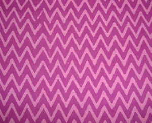 violet bead on pink yoke-tunic fabric