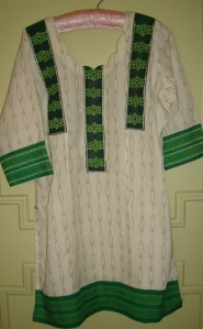 kutchwork on cream and printed green tunic