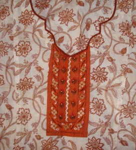 orange yoke on white/ brown tunic