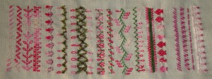 20.114.long tailed chain stitch plain and beaded sampler