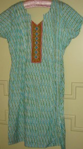 orange yoke on white blue green tunic